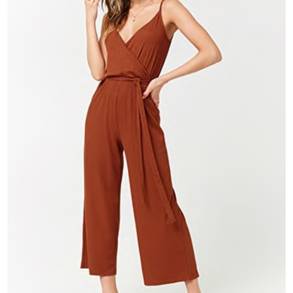 lower price with watch search for genuine Rust colored jumpsuit w/ leg slits